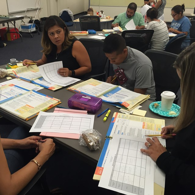 Teachers collaborate during their training to finds new ways to enrich the educational experience for our students.