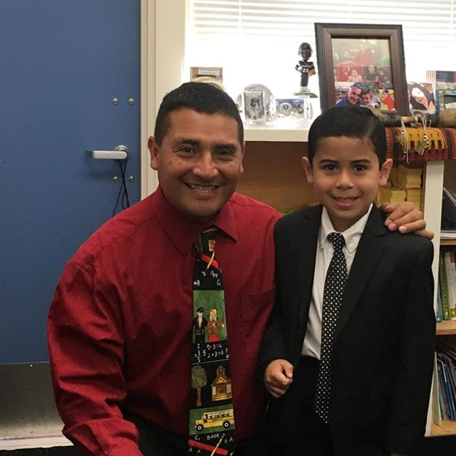 Principal Loya takes a break to let this student fill in as Principal for the Day!