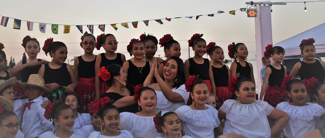 Maestra Tavares and Maestra Zamora celebrate with the Balet Foklorico Dance Group